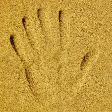 Hand print on send photo