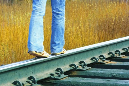 wood railroads: Walking on railroad Stock Photo