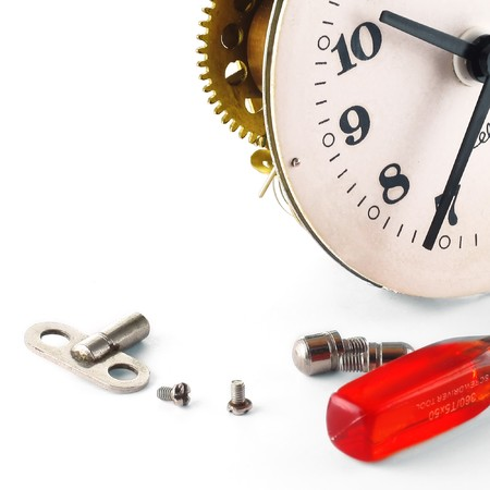 disjoint: Broken clock with screws over white Stock Photo