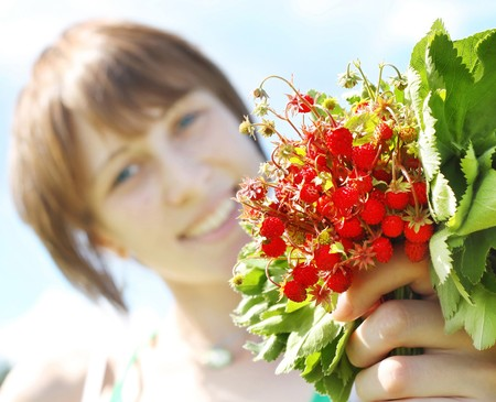 srawberry: Young smiling woman with srawberry bouquet Stock Photo