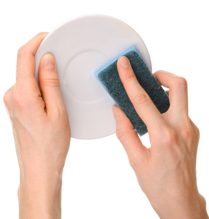 Hands with plate and sponge photo