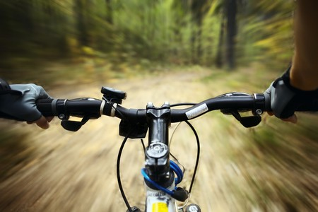Riding on a bike in forests path photo