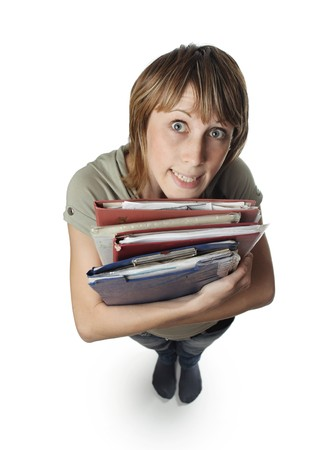 grimace: Young woman with heap of papers