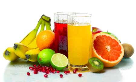 Collection of a ripe wet tropical fruits with juice glasses photo