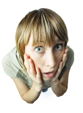 Young woman with hands on cheeks photo