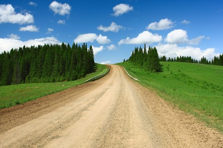 Rural road and blue sky with clouds photo