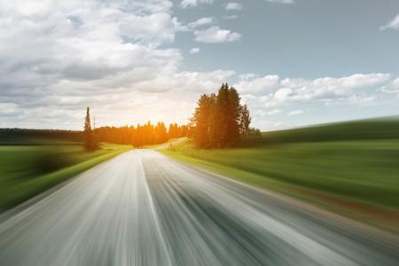 Asphalt blurry road on rural landscape photo