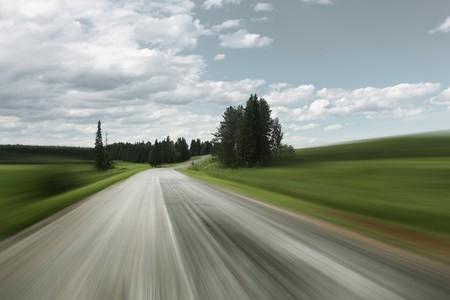 Asphalt blurry road on rural landscape Stock Photo - 7600138