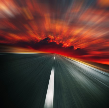 speed race: Blurred asphalt road and red bloody blurred sky Stock Photo