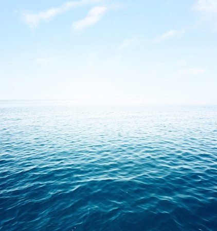 rare: Blue sea with waves and clear blue sky Stock Photo