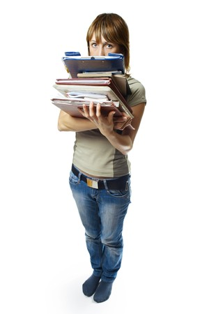 inclination: Young woman holding stack of papers over white background