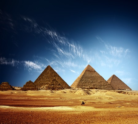 Giza valley with Great pyramids and blue sky with clouds photo