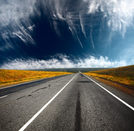 Asphalt road and blue sky with clouds Stock Photo - 7634688