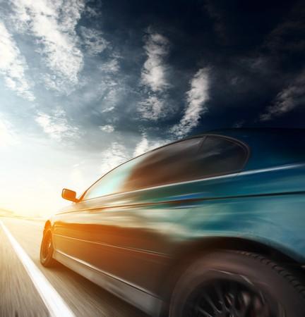 Motion blurred car on asphalt road Stock Photo - 7791381
