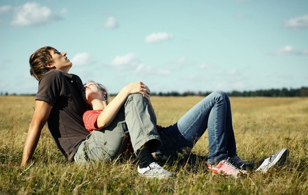 Young couple relaxing on a meadow Stock Photo - 7791424