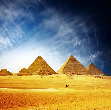 Greate pyramids in Giza valley and rider on camel. Egypt photo
