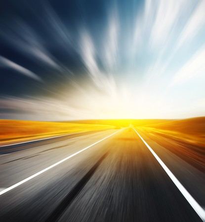 Motion blurred asphalt road and blurred sky with clouds Stock Photo - 7791386