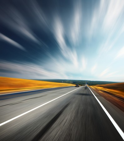 Motion blurred asphalt road and blurred sky with clouds Stock Photo - 7791411