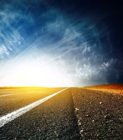 race track: Asphalt road and sky with clouds