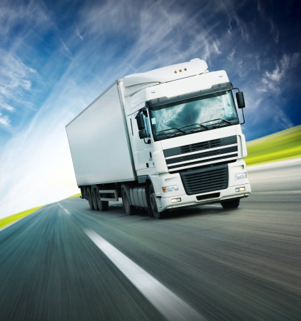 freight: White truck on asphalt blurry road Stock Photo