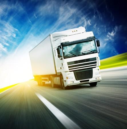 White truck on asphalt blurry road Stock Photo