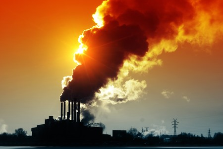 environmental issues: Power plant with smoke and dirty orange air