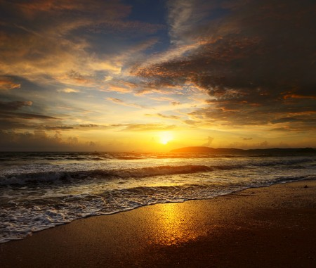 lake shore: Sunset over sea with clouds