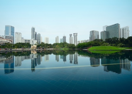 malaysia city: Buildings of a city with reflection in water. Kuala Lumpur Stock Photo