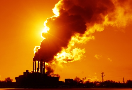 Power plant with smoke and dirty orange air  photo