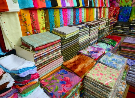 batik: Colored textile in a traditional east market in Malaysia.