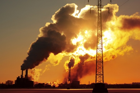 environmental safety: Power plant with huge smoke and electric towers