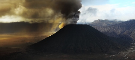 Ash eruption of the Bromo volcano. East Java. Indonesia photo