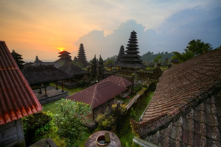 Yard with green trees and buildings of indonesian old temple Pura Besakih at sunset light. Bali. HDR image photo