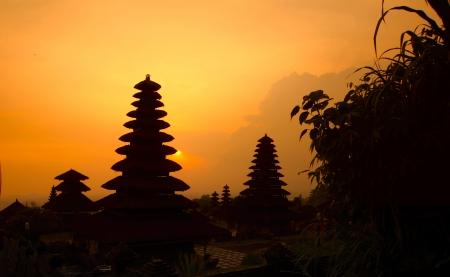 pura: Indonesian old temple Pura Besakih at red sunset light. Bali