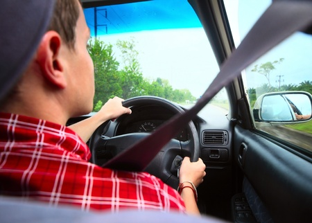 Young man driving a car with safety belt Stock Photo - 9912232
