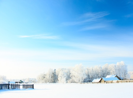 Buildings in a village at sunny winter day with blue sky photo