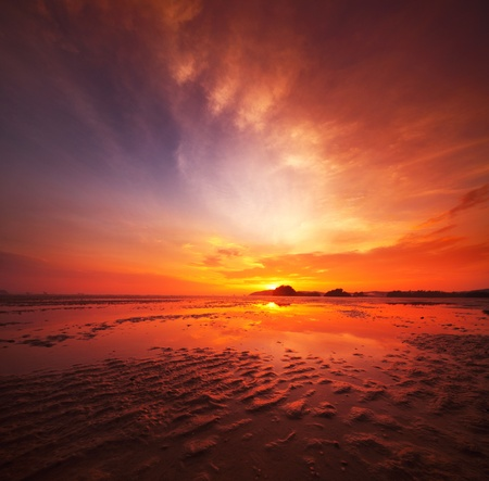 beach sunrise: Sunset over sandy beach in low tide Stock Photo