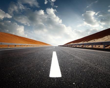 race track: Empty asphalt road and cloudy sky