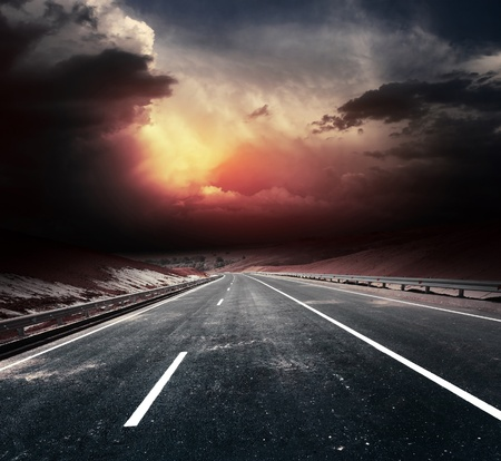 Dirty asphalt road and dark thunder clouds Stock Photo - 11540872