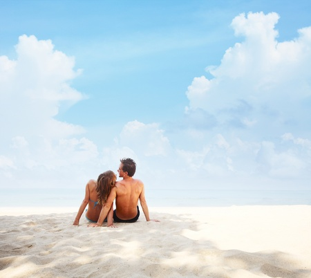Young couple relaxing on a tropical resort photo