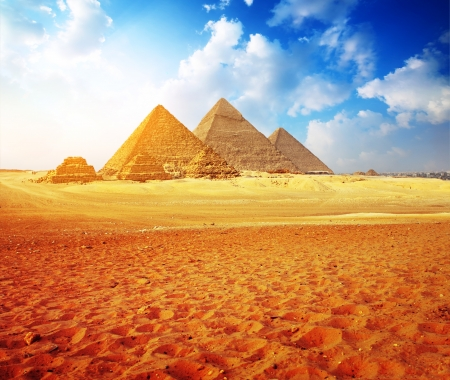 Giza valley with Great pyramids with blue cloudy sky