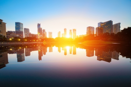 Sunrise over pond in a city. Kuala Lumpur skyline Stock Photo - 11540948