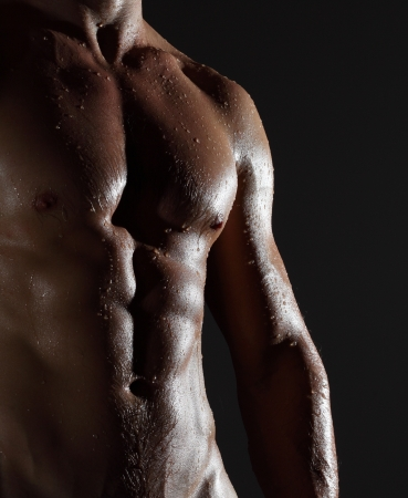 wet men: Part of a wet mans body on a gray background