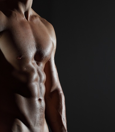 torsos: Part of a wet mans body on a gray background
