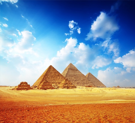 egyptian pyramids: Giza valley with Great pyramids with blue cloudy sky