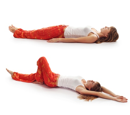 yoga pants: Young woman in red pants doing yoga exercises isolated on a white