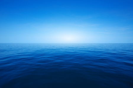still water: Blue clear sea and sky Stock Photo