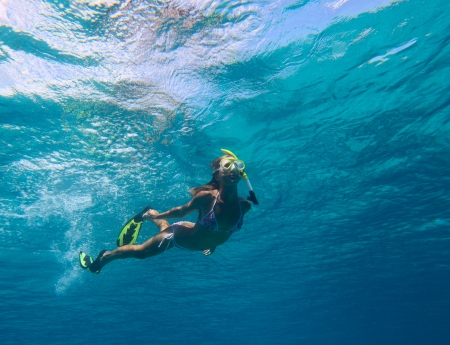 Underwater shoot of a young woman in clear sea photo