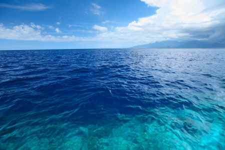 shore line: Blue clear sea with waves and sky with clouds
