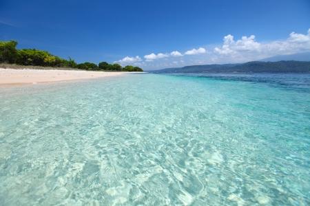 Sandy coast and clear sea of the Bali Barat National Park. Java island on the horizon (right) Stock Photo - 16835710